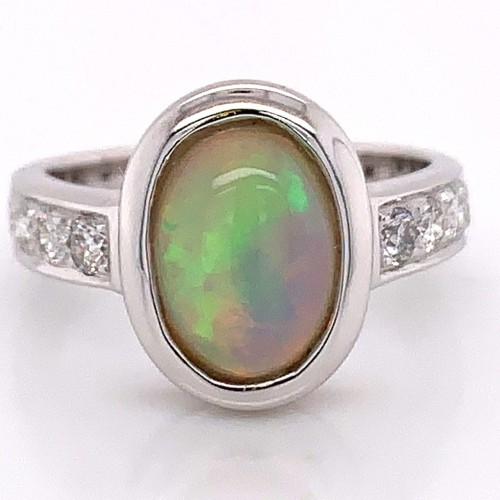 The Danisa Oval Cut Opal and Round Diamond Engagement Ring in a 14kt White Gold