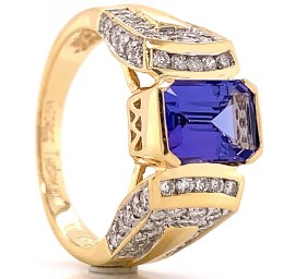 The Timona Emerald Cut Tanzanite and Round Diamond Ring in 14kt Yellow Gold